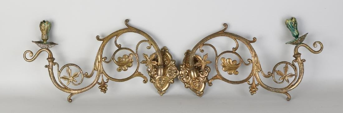 Two gold-plated brass Neo Gothic wall sconces with