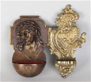 Two antique bronze (wall) holy water containers.