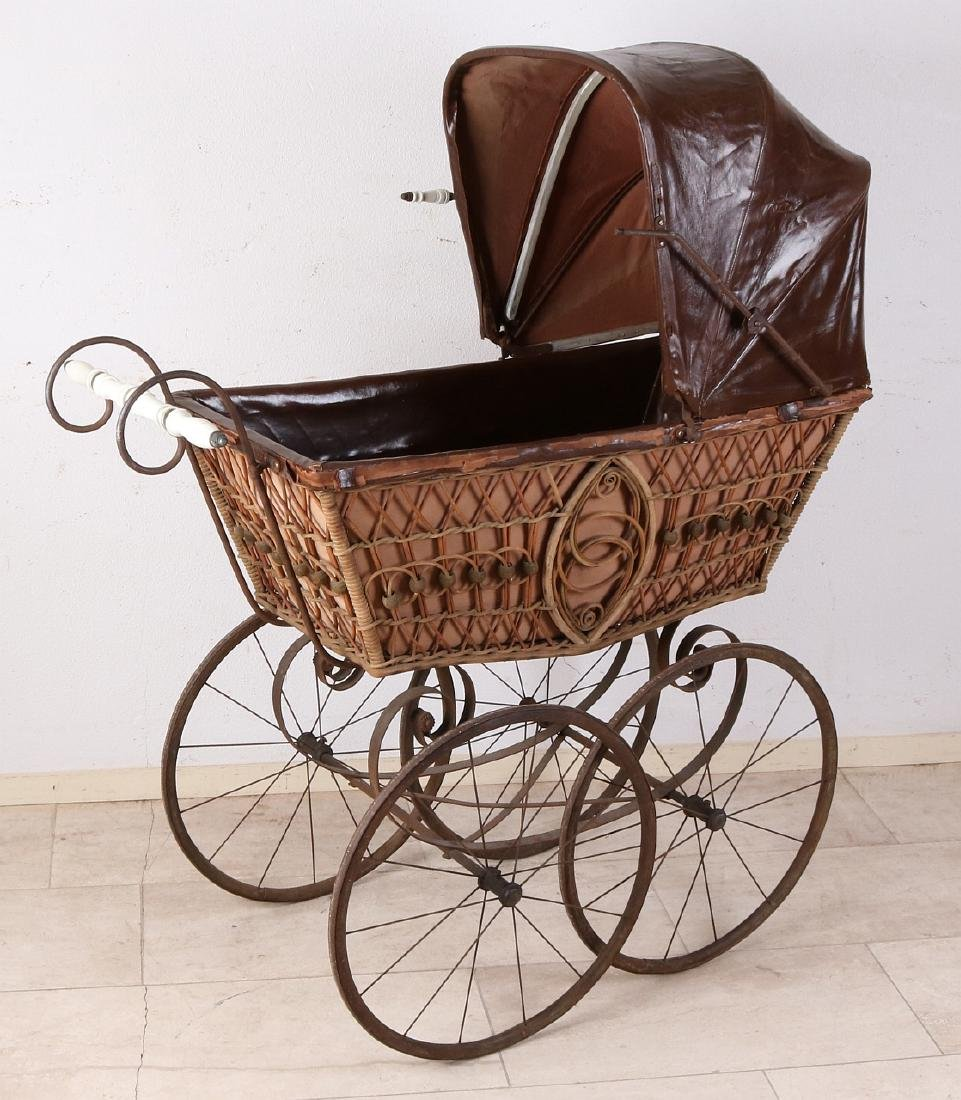 19th century pram on high wheels with leaf suspension,
