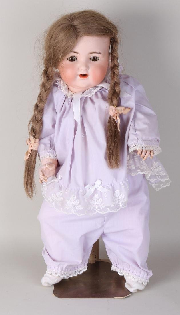 Antique German porcelain doll with baby body. Armand