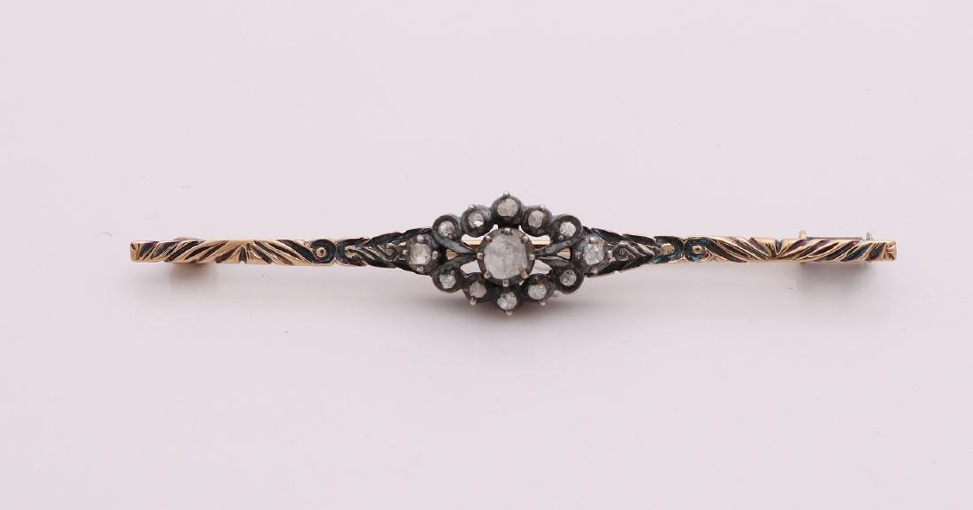Golden brooch, 585/000, with diamonds. Bar brooch of