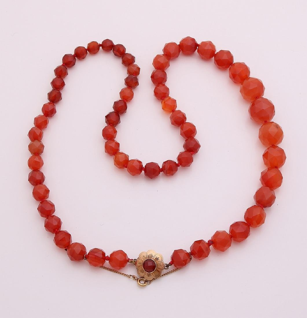 Necklace of faceted carnelian beads, running in width,