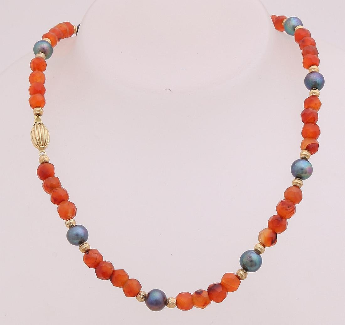 Necklace with faceted carnelian beads, with golden