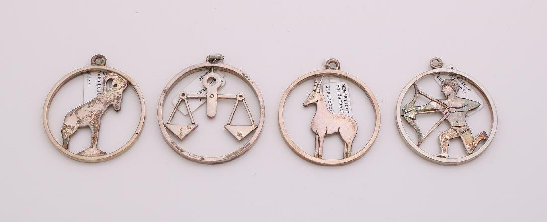 Lot with four silver zodiacs, 925/000, handmade. Round