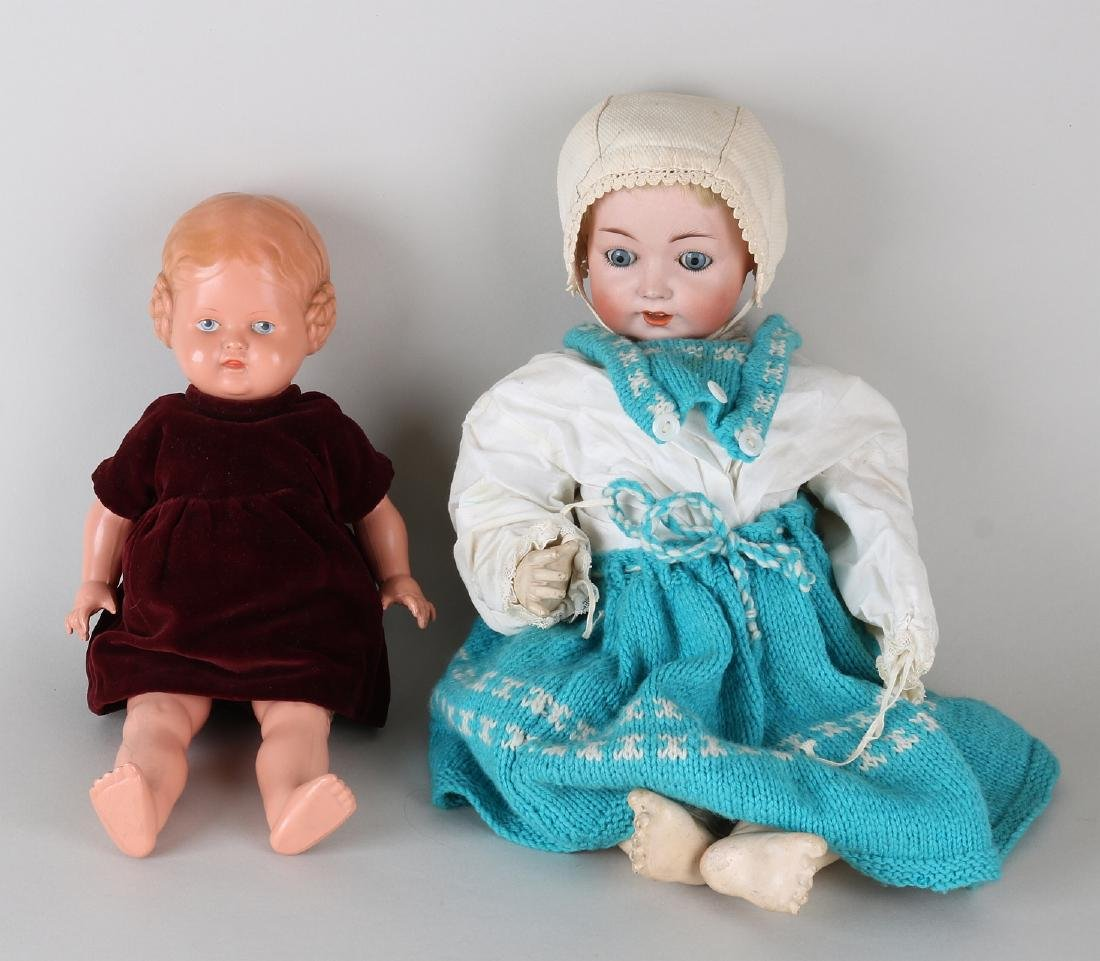 Two antique German dolls. One time porcelain with baby