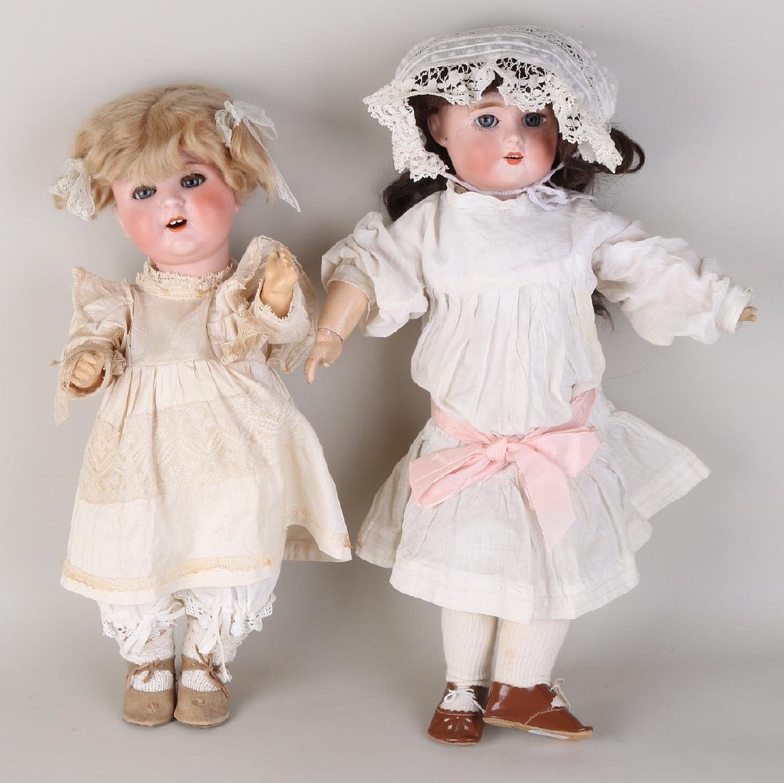 Two antique German porcelain dolls. One time