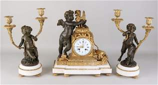 Rare 19th century French bronze clock set by Clodion.