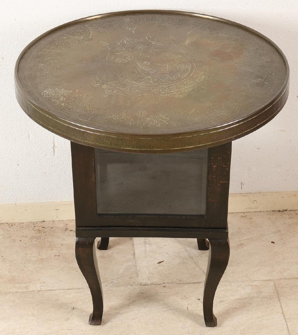 Old smoking table. Dark-stained with copper-stained