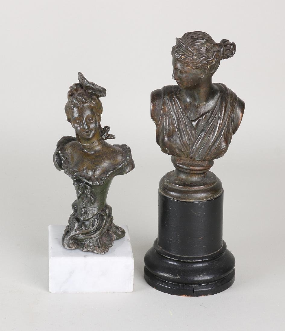 Two antique busts. One lady on a white marble base.