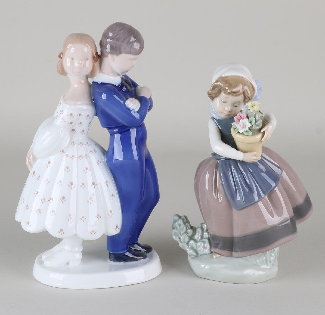 Two old porcelain figures. One time flower girl