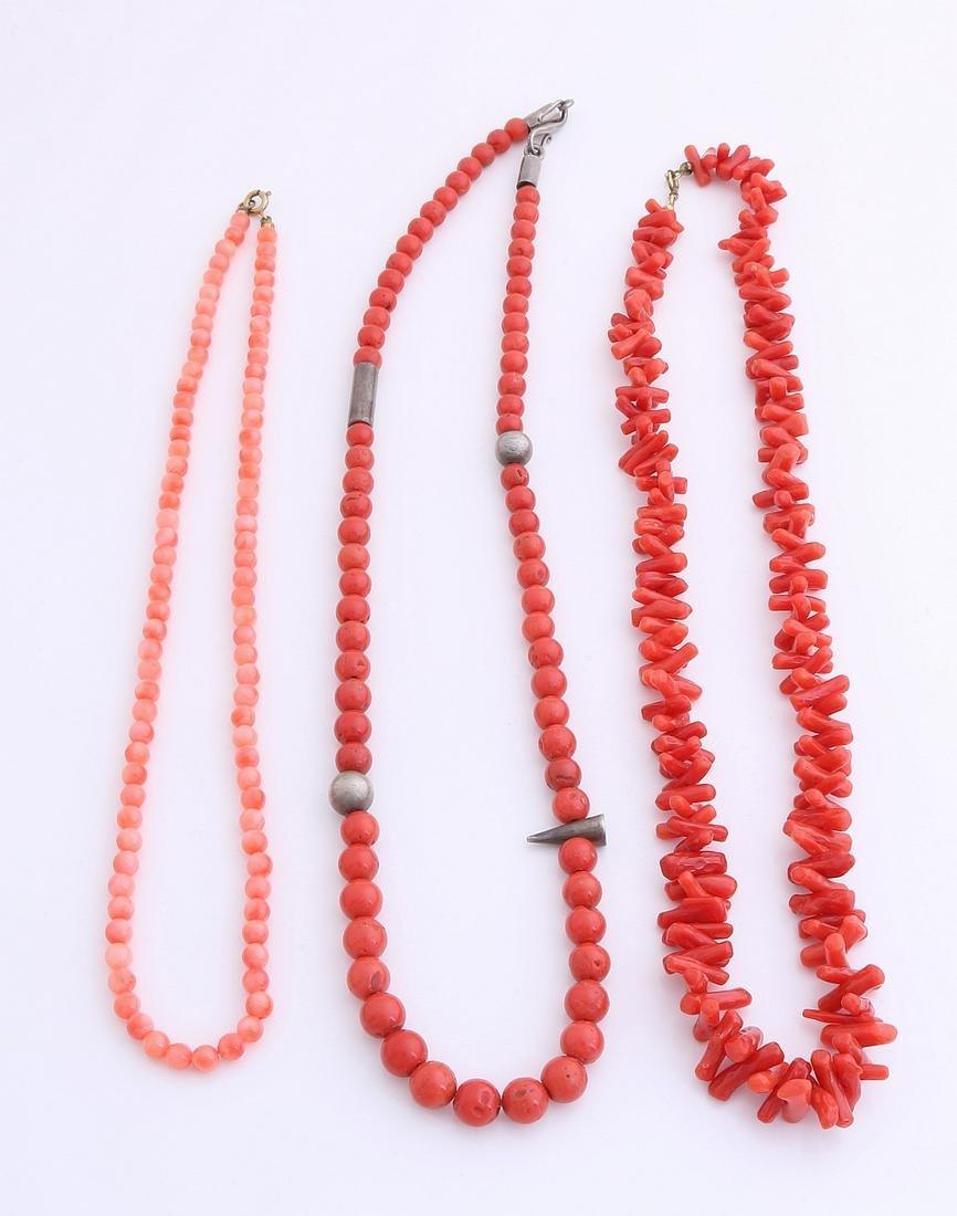 Three coral necklaces. a necklace of twigs coral, 12