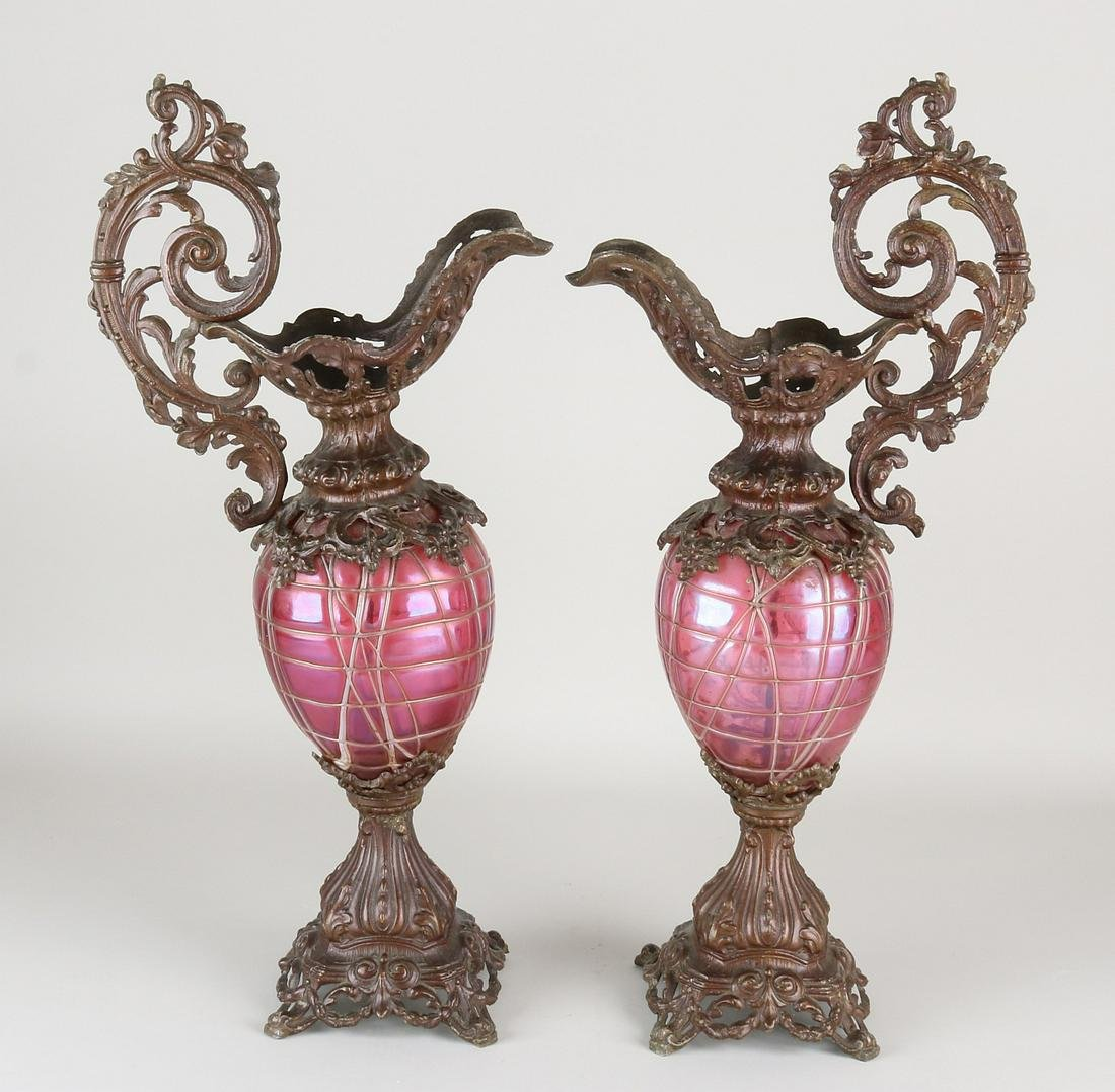 Two large antique historicism jugs with cassis-colored