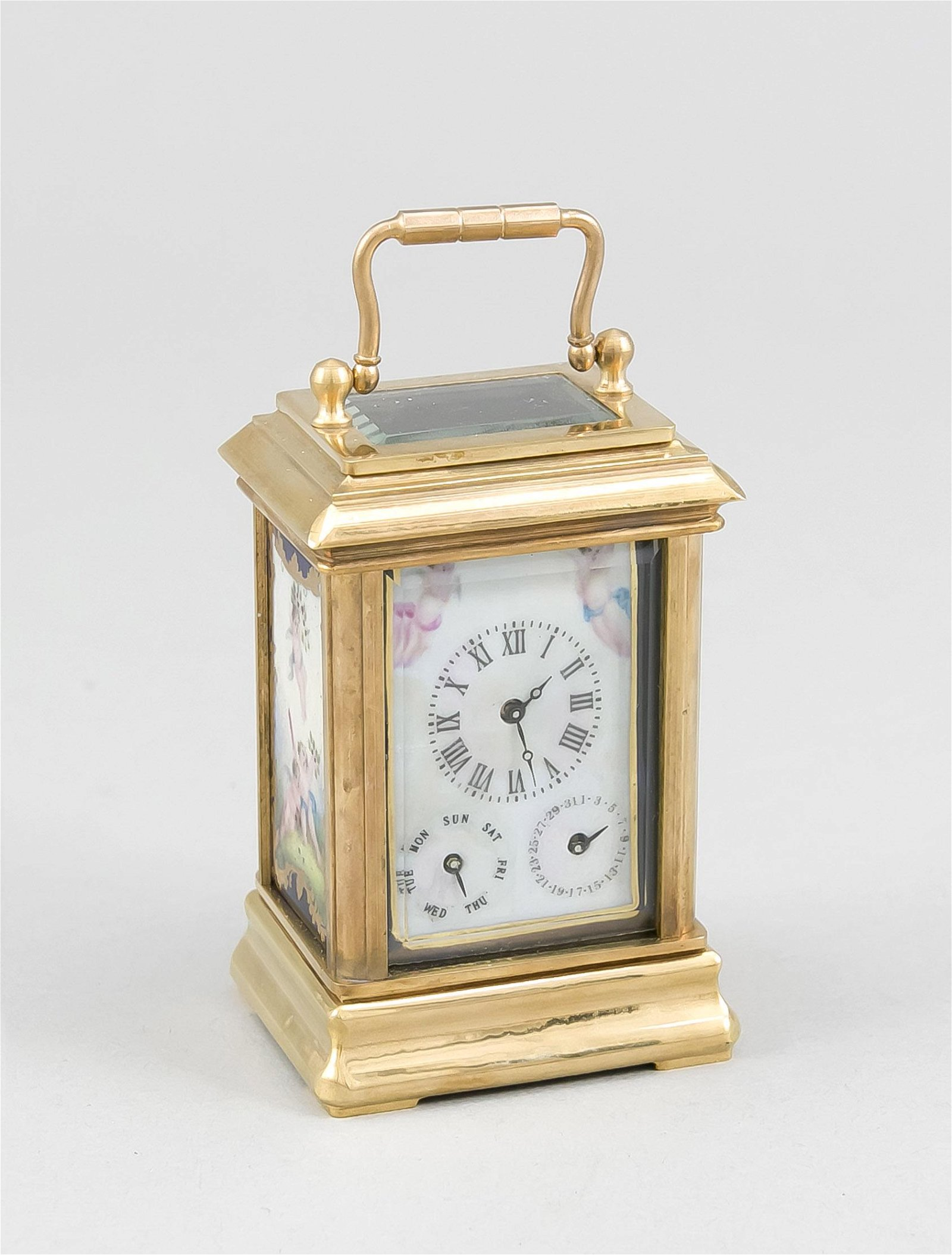 Small brass travel alarm clock with porcelain plaques.