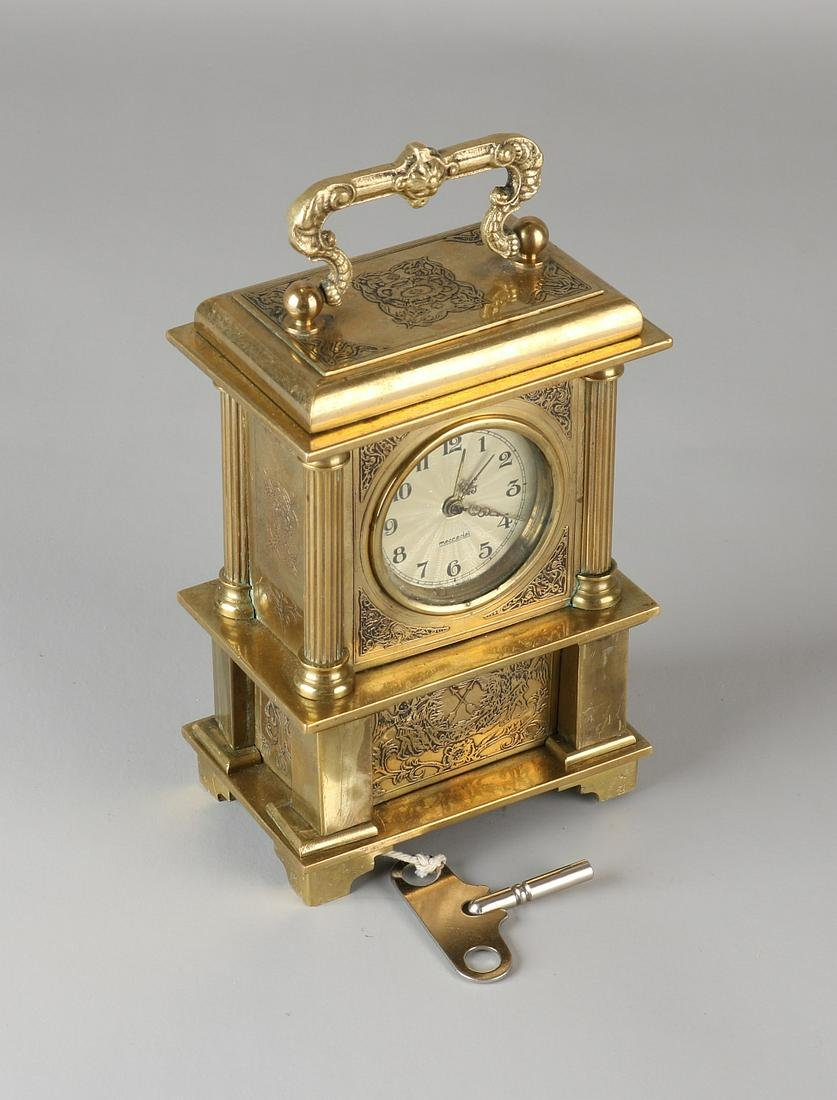 Brass travel alarm clock with Reuge playing. Mercedes