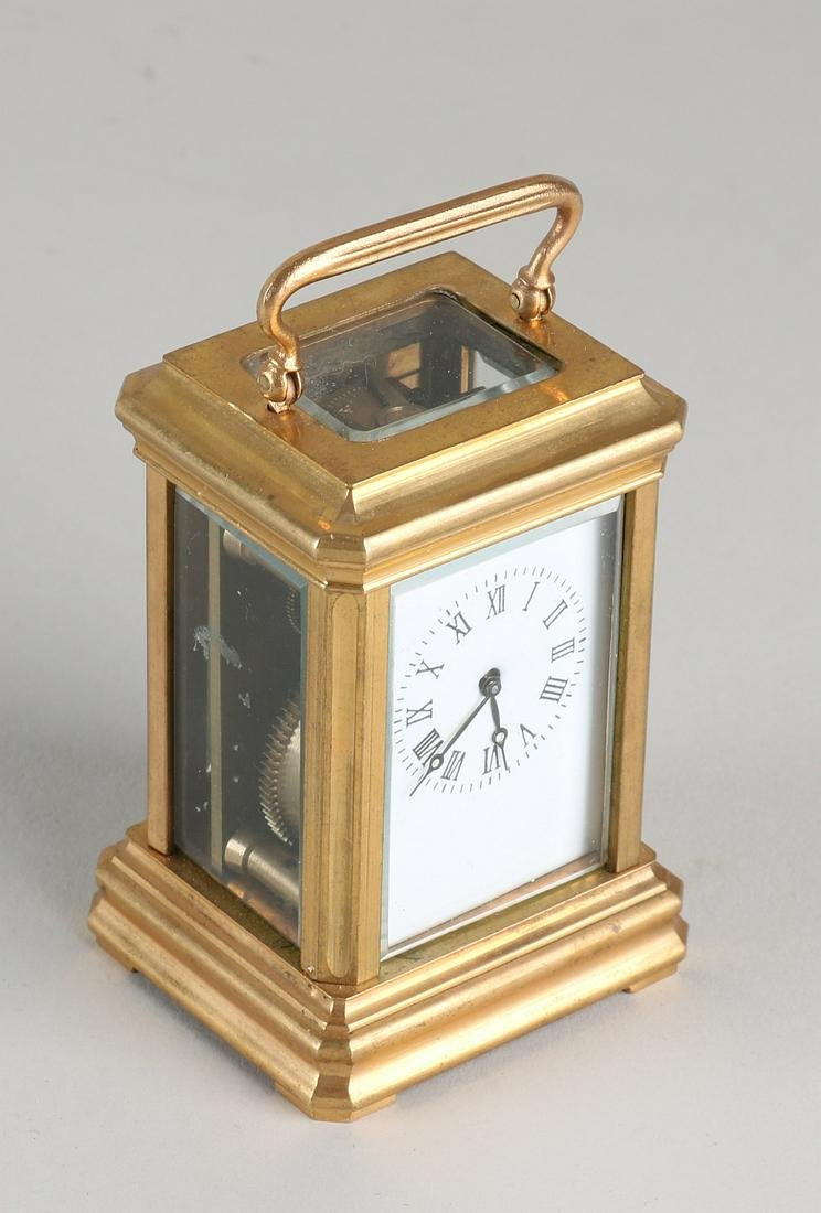Small brass travel alarm clock with cut glass and