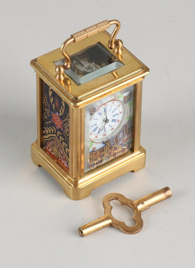 Small old mini travel alarm clock. Brass with porcelain