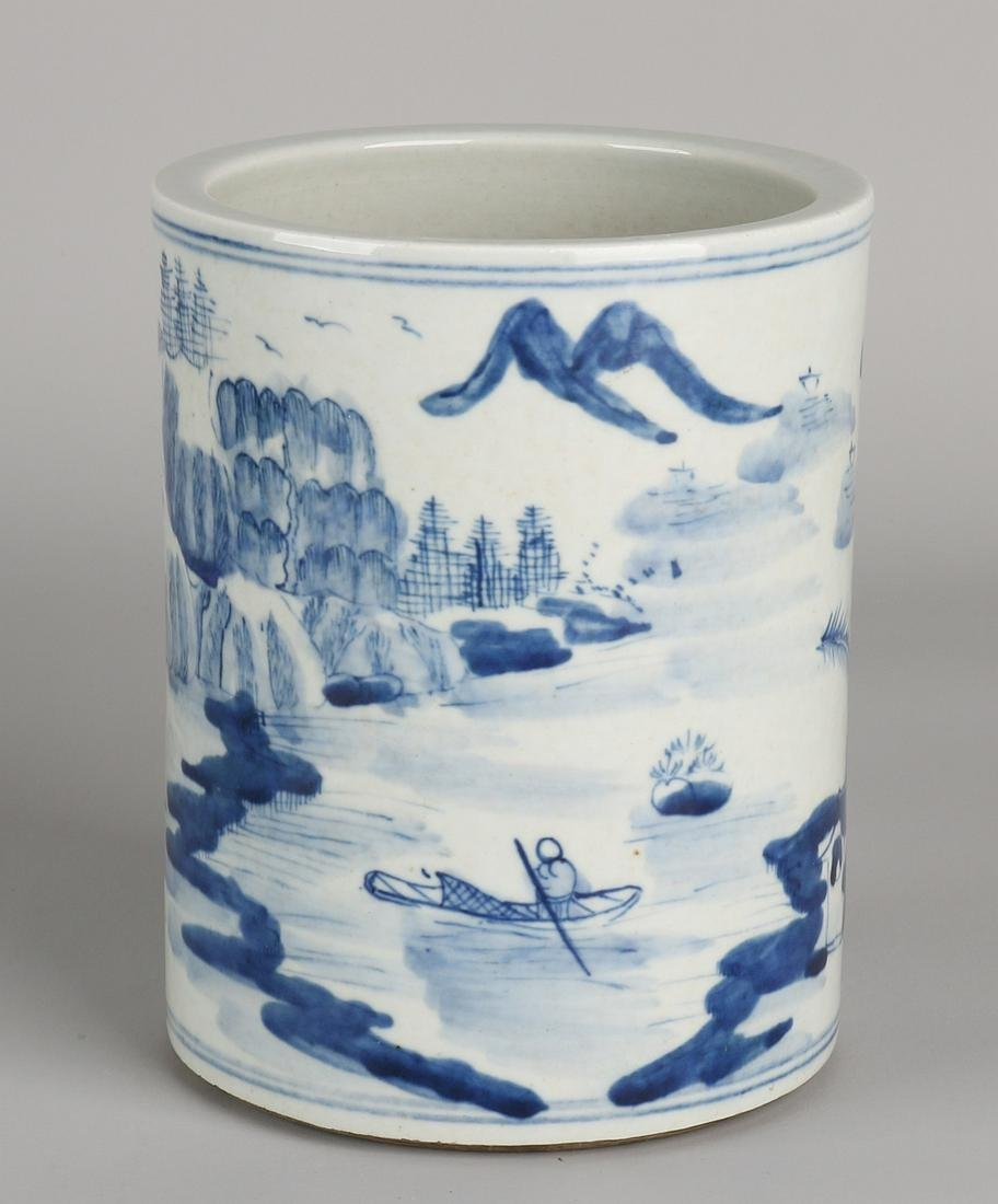 Antique Chinese porcelain brush pot with a backdrop of