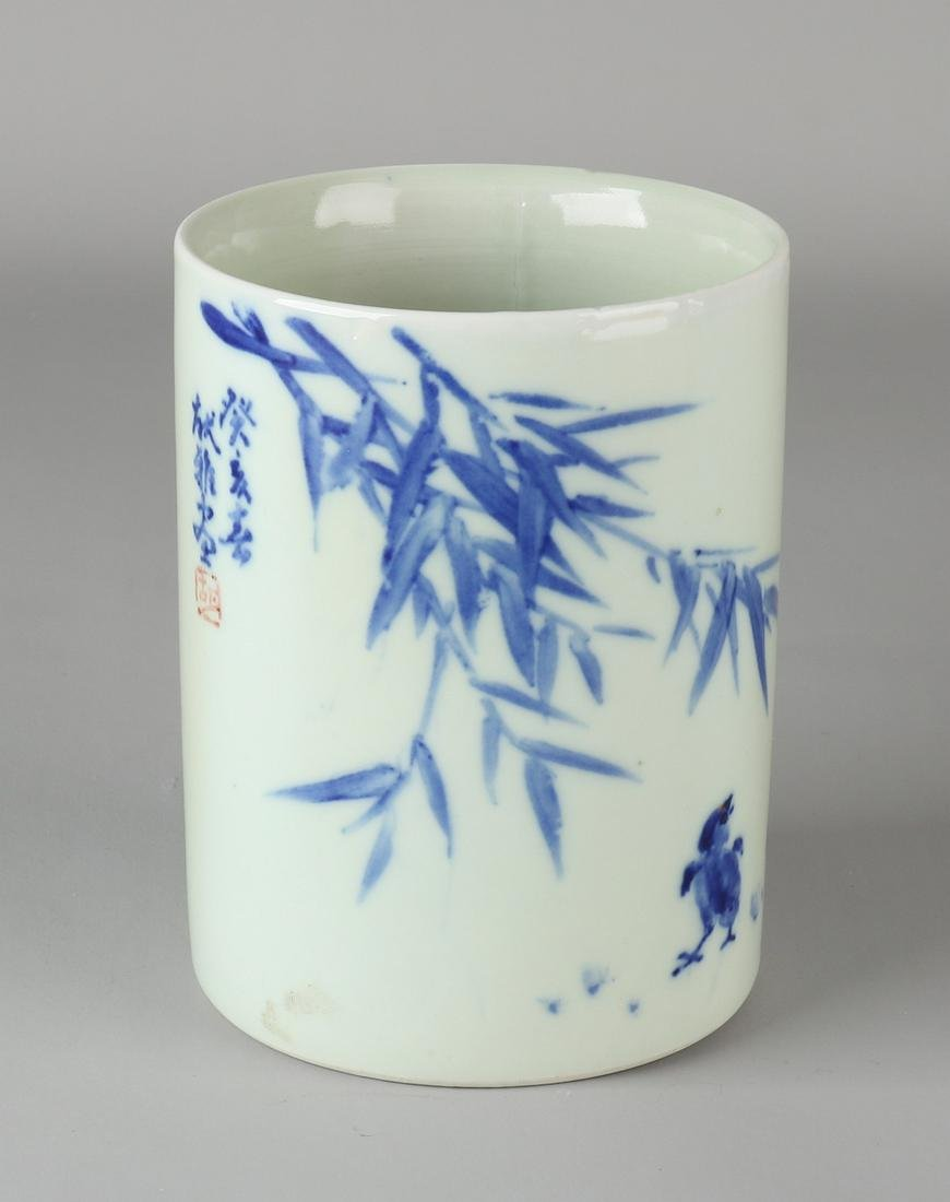 Old Chinese porcelain brush pot with bamboo and