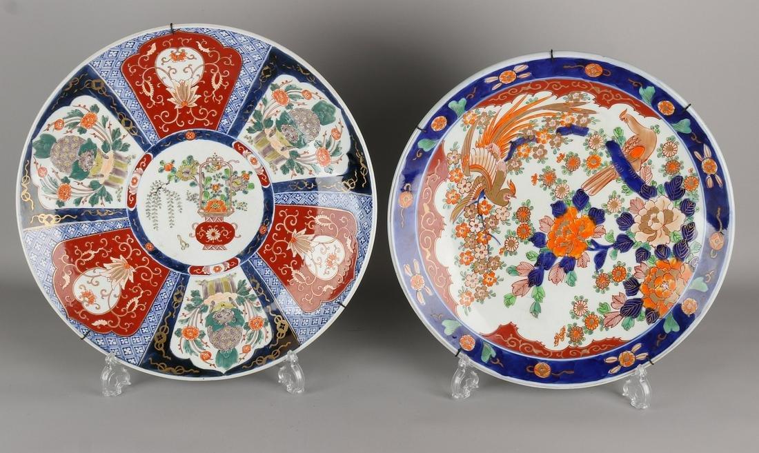 Two large antique Imari porcelain decorative dishes.