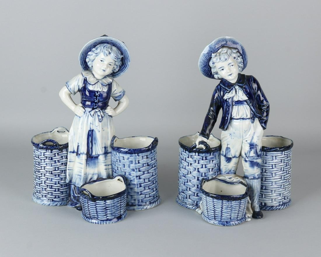 Two antique Delft porcelain figures. Boy and girl with