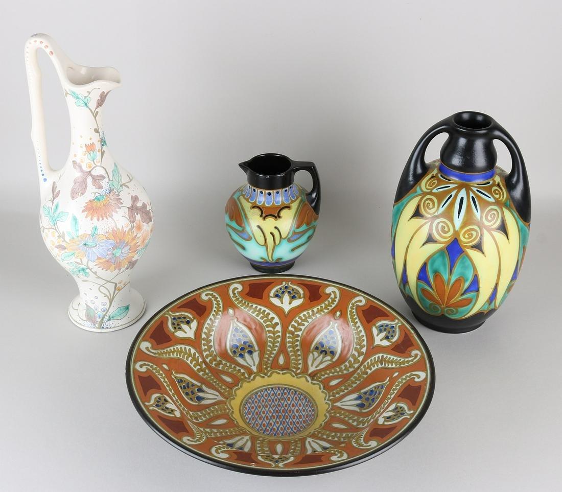Four times antique Dutch pottery. Damages. Consisting