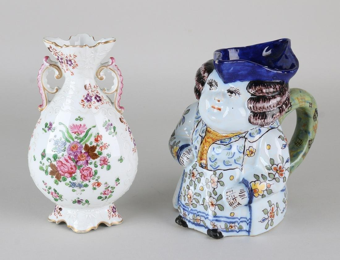 Twice ceramics. Consisting of: Vase, France, hairline,