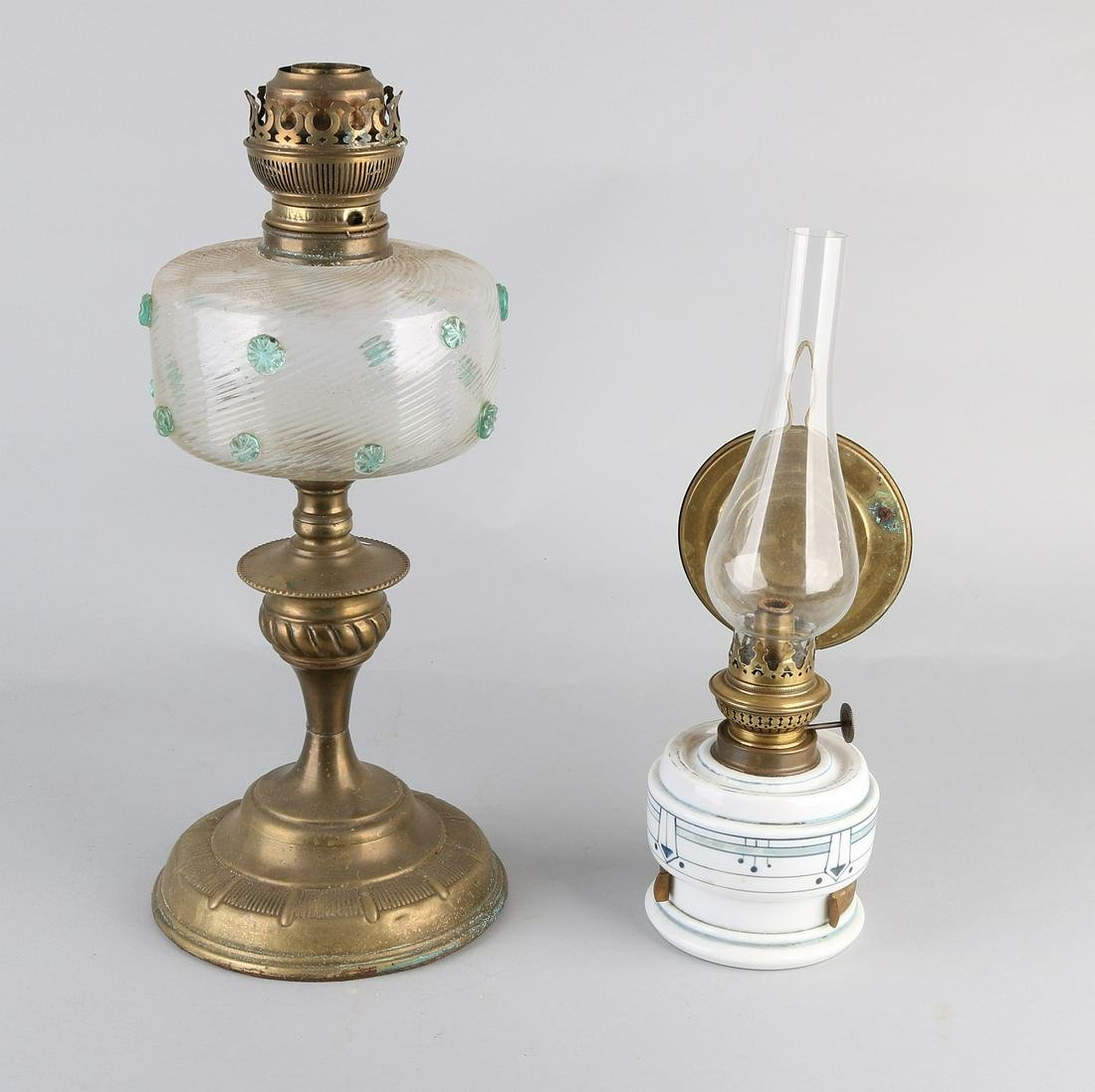 Two antique kerosene lamps. One Jugendstil glass