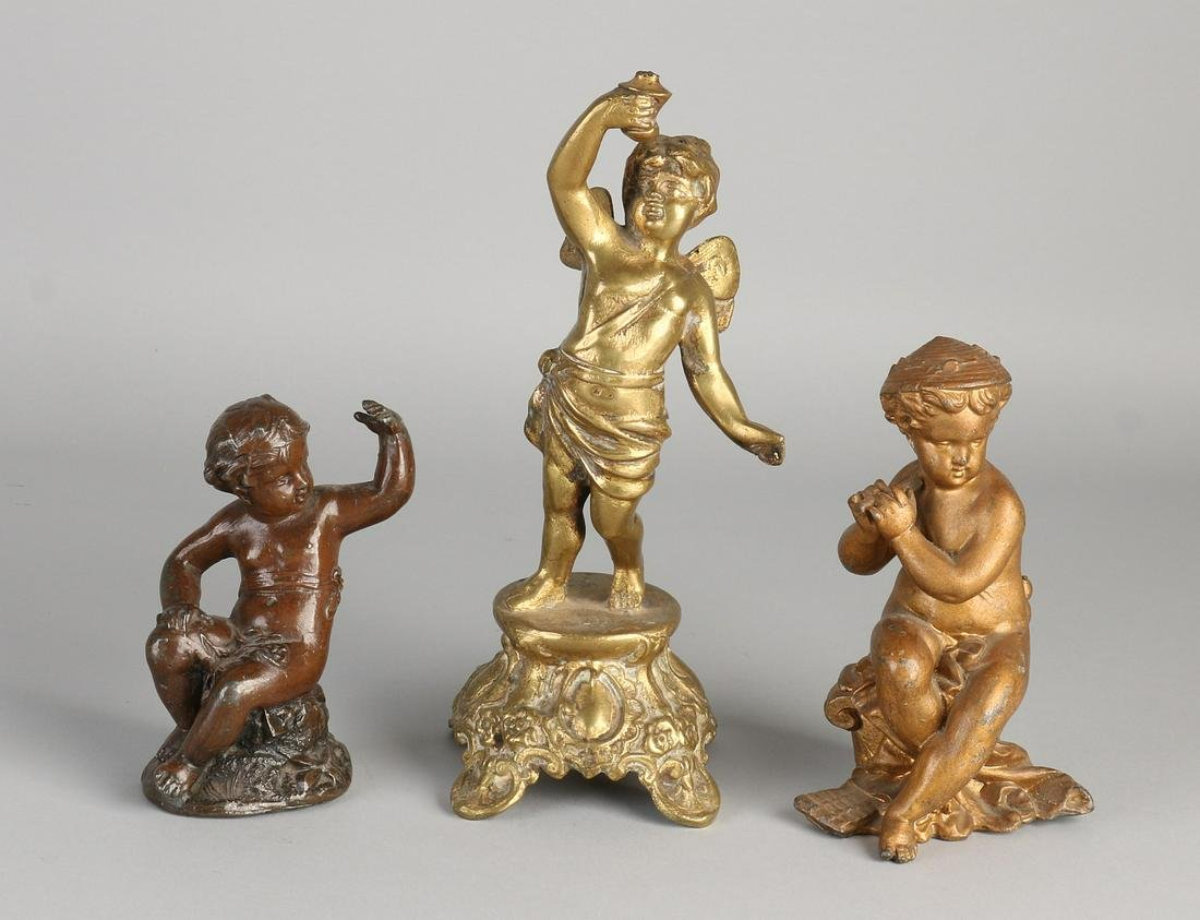 Three antique metal figures. Among others: once putti