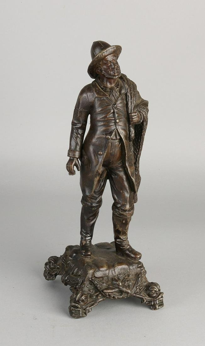 Antique composition metal figure. Fisherman with safety