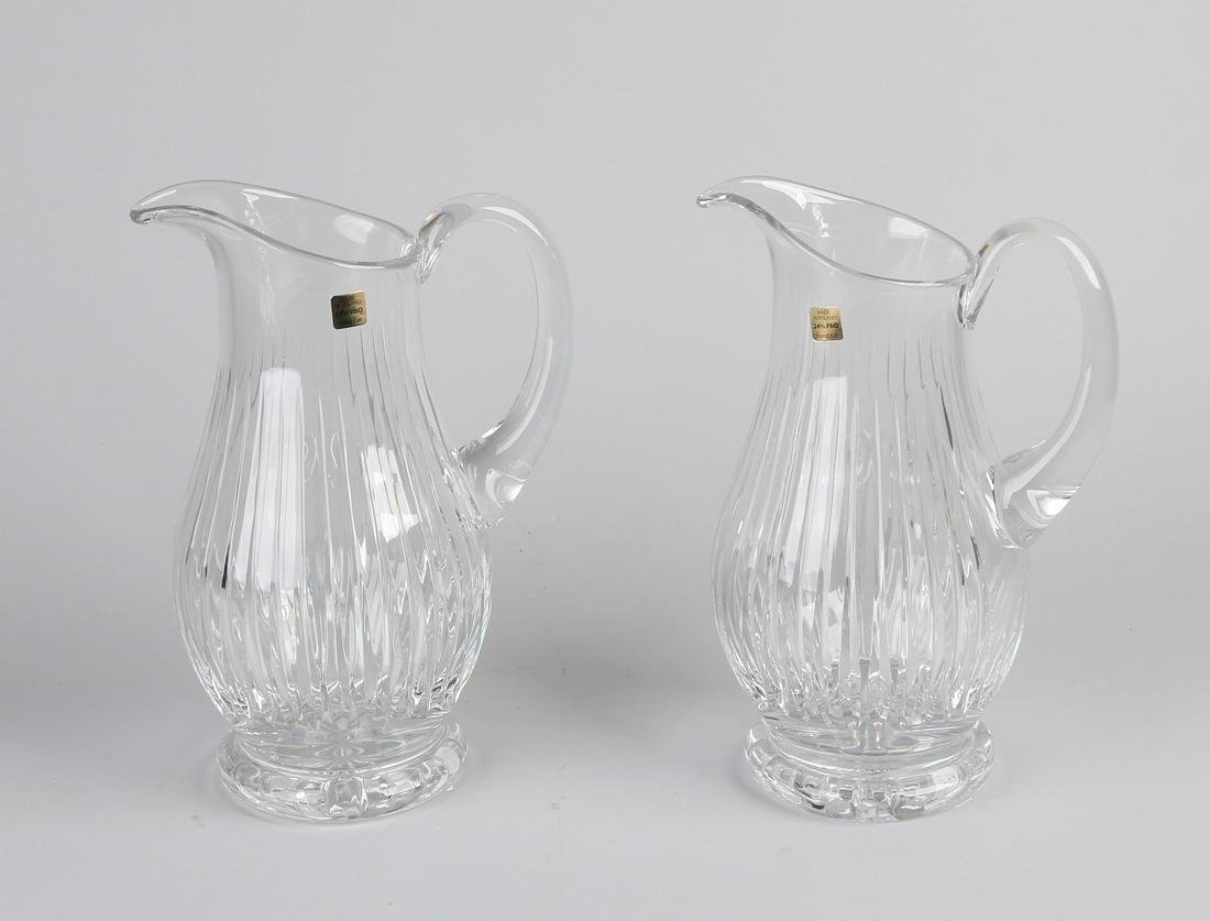 Two large heavy crystal glass facet cut wine carafes.
