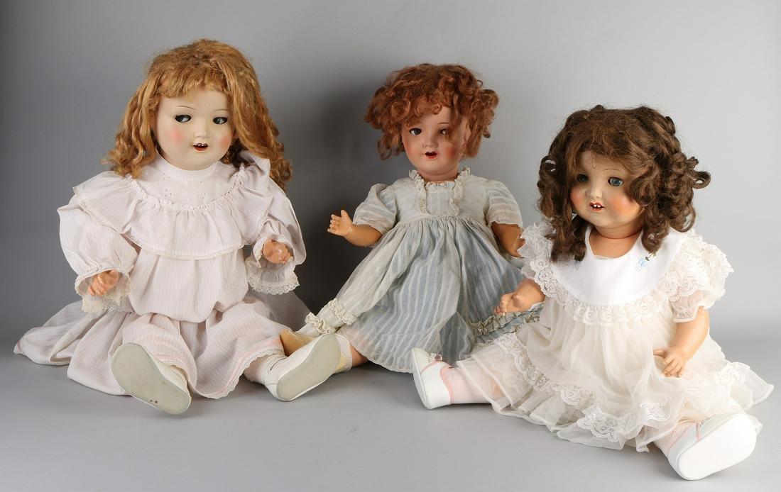 Three large German Sonneberg dolls with paper mache