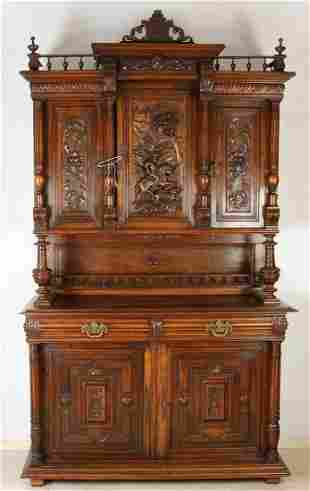 Antique French walnut carved Henri Deux cupboard with