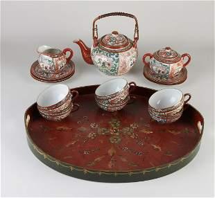 Antique Japanese eggshell porcelain tea set on a