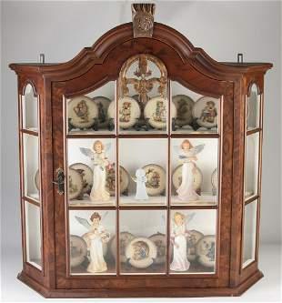 Walnut hanging display case full of 25 Goebel plates