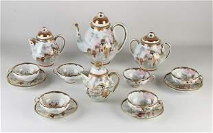 Antique nine-piece Japanese eggshell porcelain tea set.
