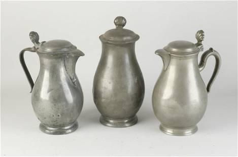 Three tin pitchers