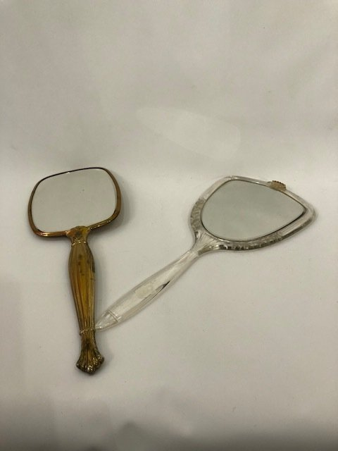Pair of vintage hand mirrors
