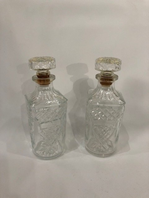 Vintage pair glass bottles with a stopper
