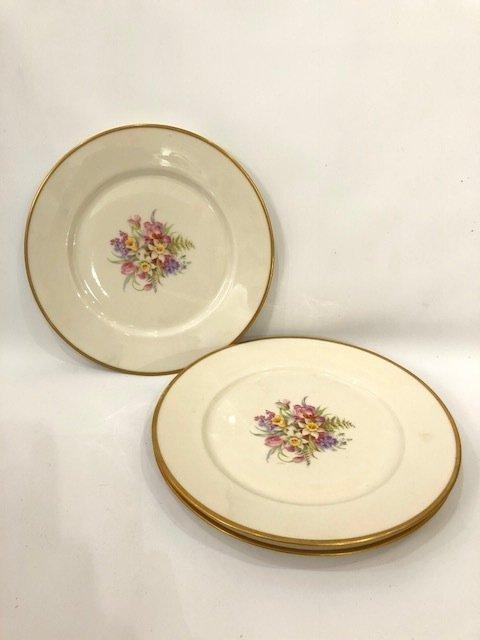 Set of 3 porcelain dinner plates signed