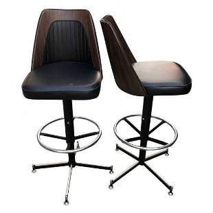 Mid century pair of counter stools with vinyl upholster