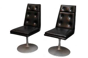 Mid century swivel black leather lounge chairs