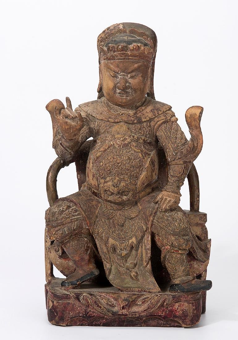 CHINA QING DYNASTY 18TH CENTURY A CARVED WOOD FIGURE OF