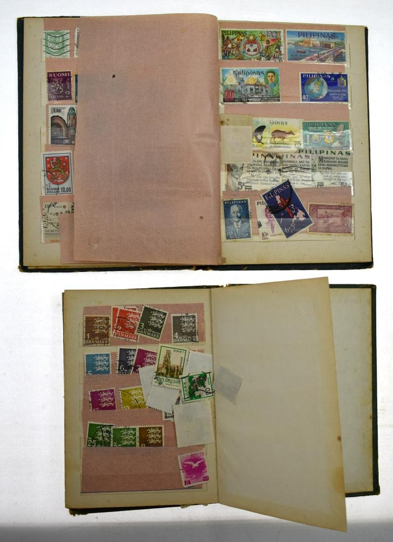 2stamp albums of stamps from all over the world