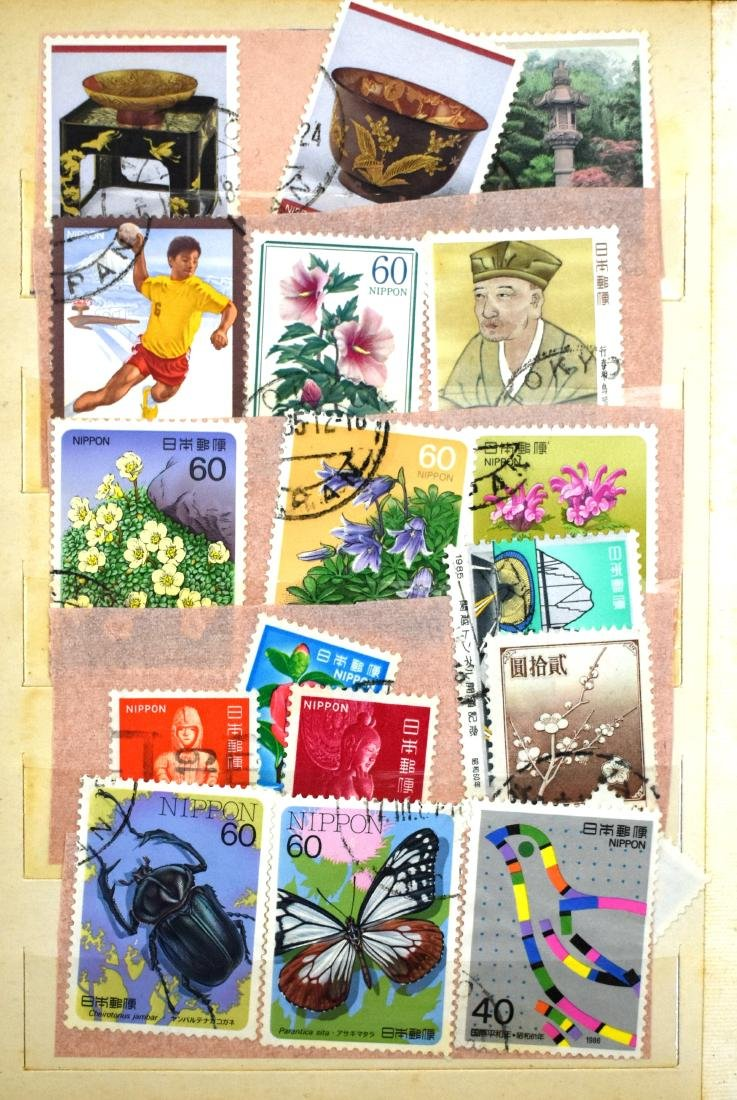 2stamp albums of stamps from all over the world - 2
