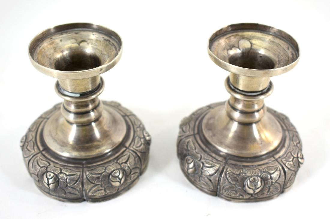 Pair of silver candlesticks, hallmarked, for use on