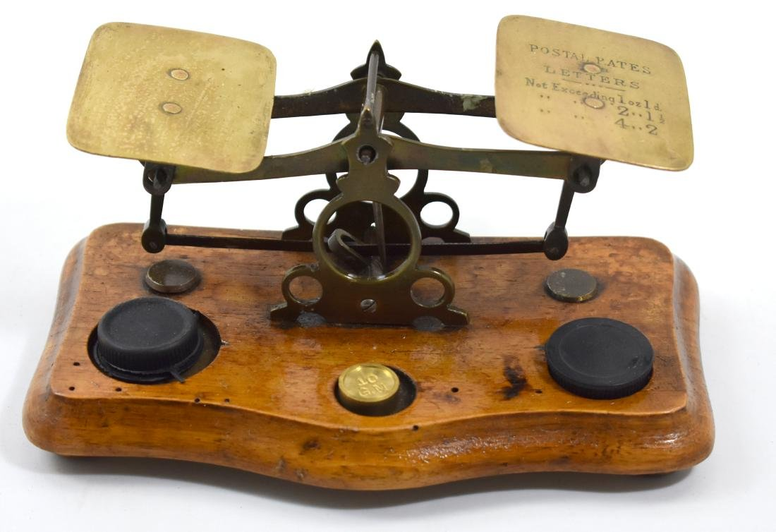Postal weights on English wooden base, writing on the