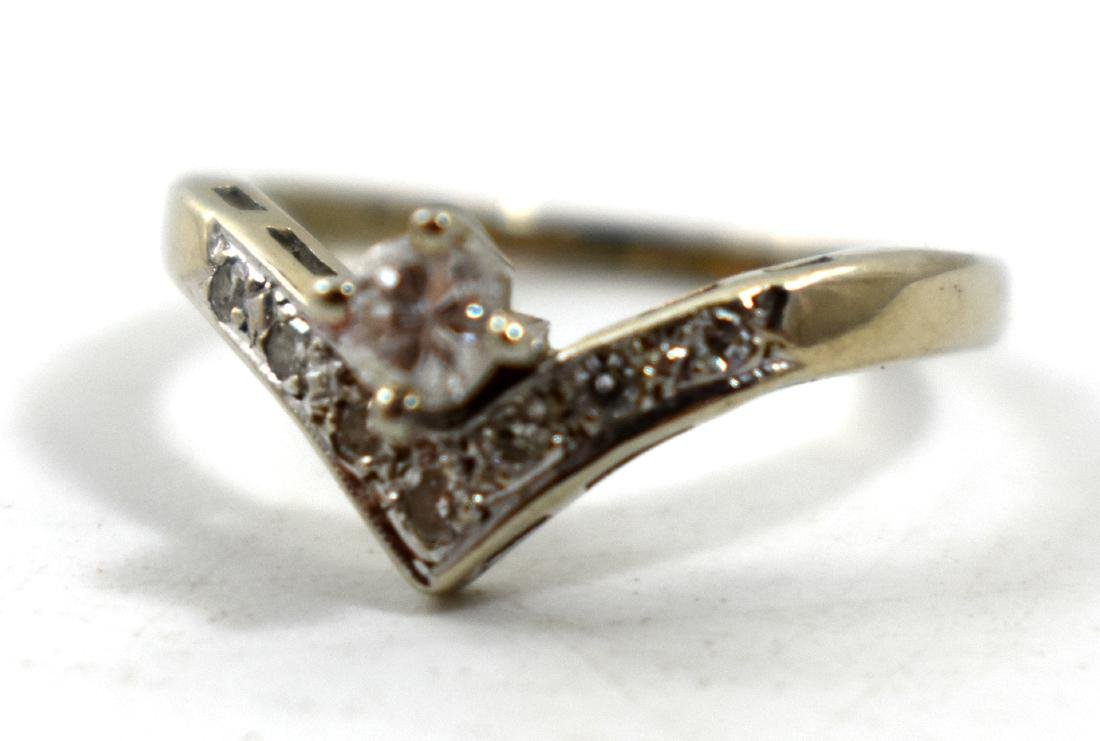 .    14k gold ring, imbedded with diamonds size 15.5,