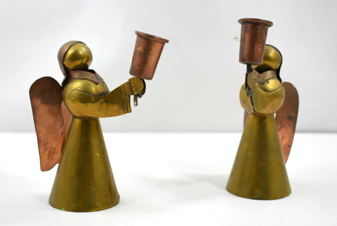 .Pair of Shabbat candlesticks in form of angels, copper