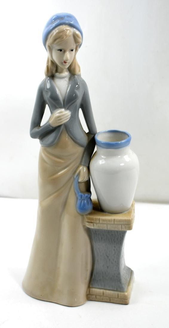 Porcelain figurine  of a woman, European