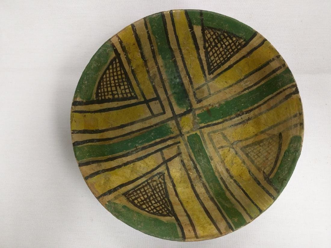 A KASHAN LUSTRE POTTERY CONICAL BOWL